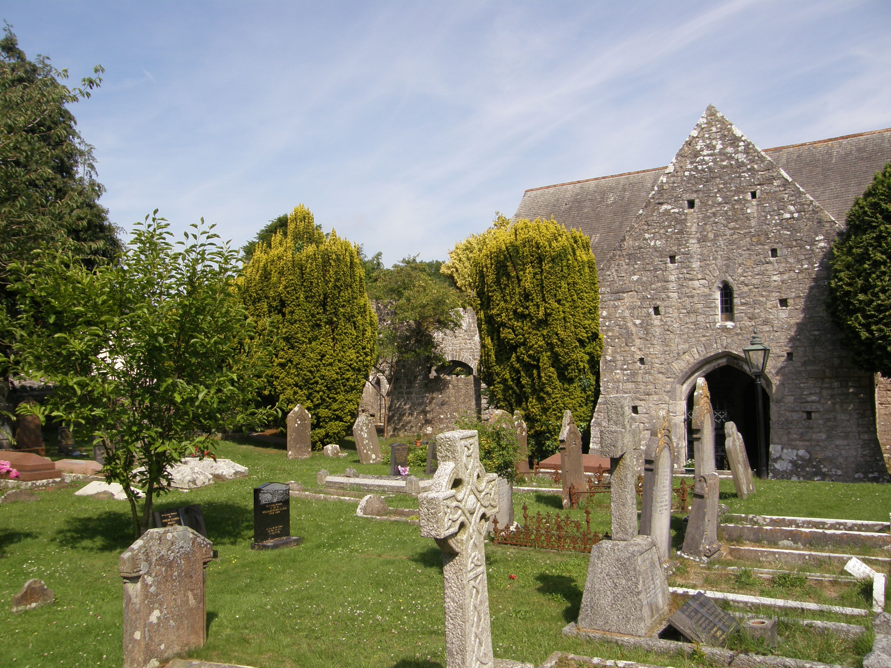 St. Illtuds Church, Llantwit Major, from church yard and showing ruined monastic chapel at west end