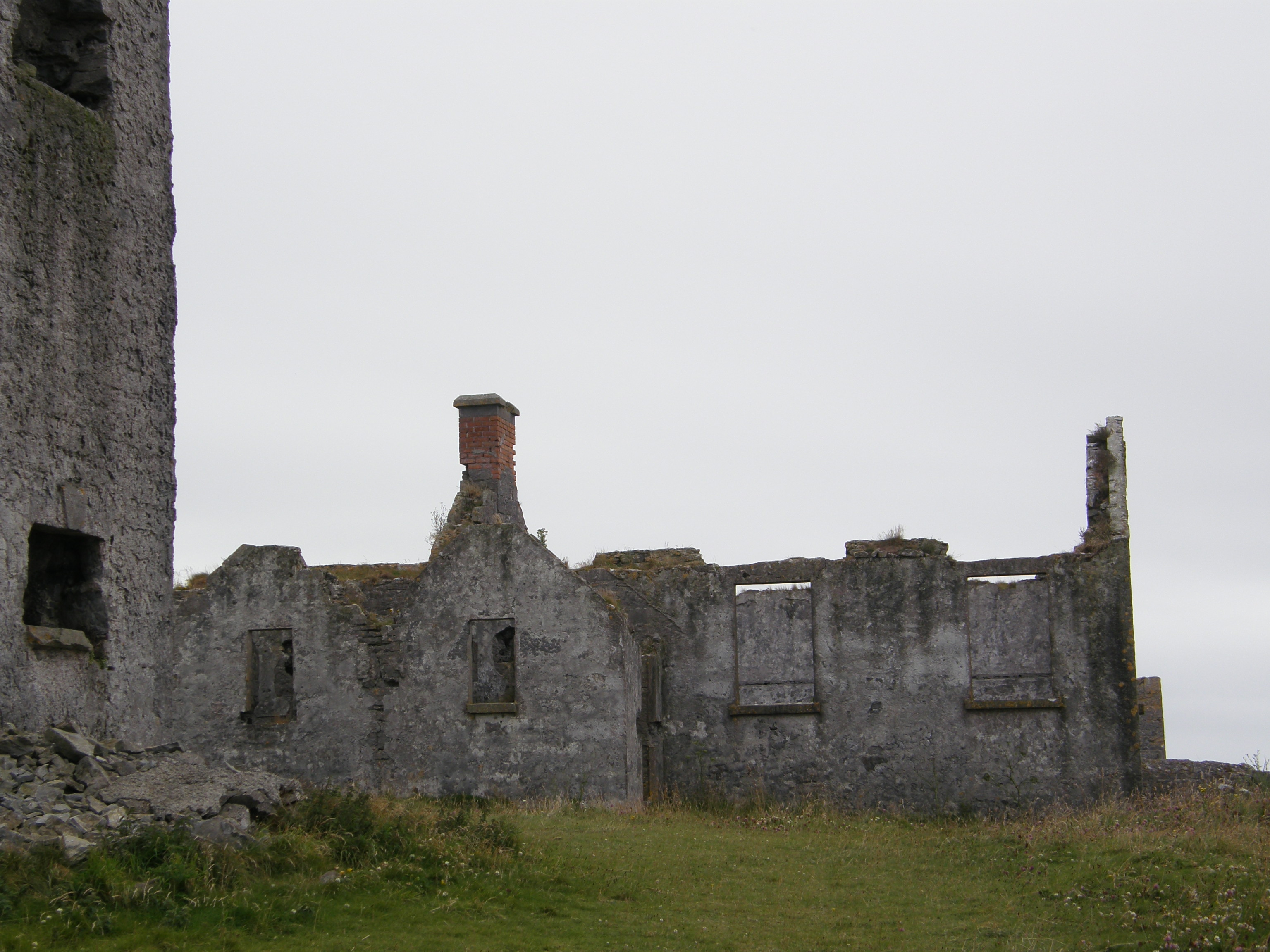 School building constructed next to, and incorporating, watchtower