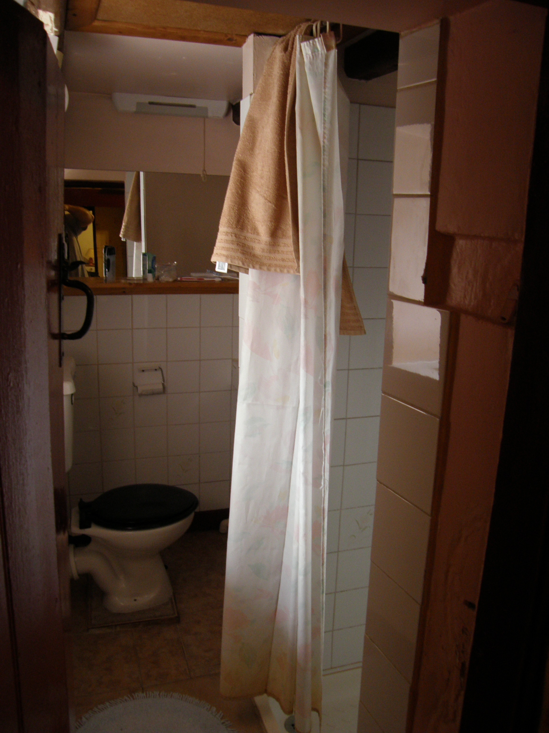 A very small bathroom, a converted pantry; indoor plumbing came in 1940