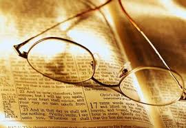 Open Bible with Eyeglasses