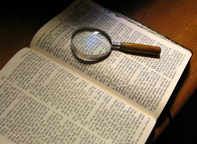 Bible and Magnifying Glass