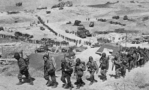 Troops marching at Omaha Beach